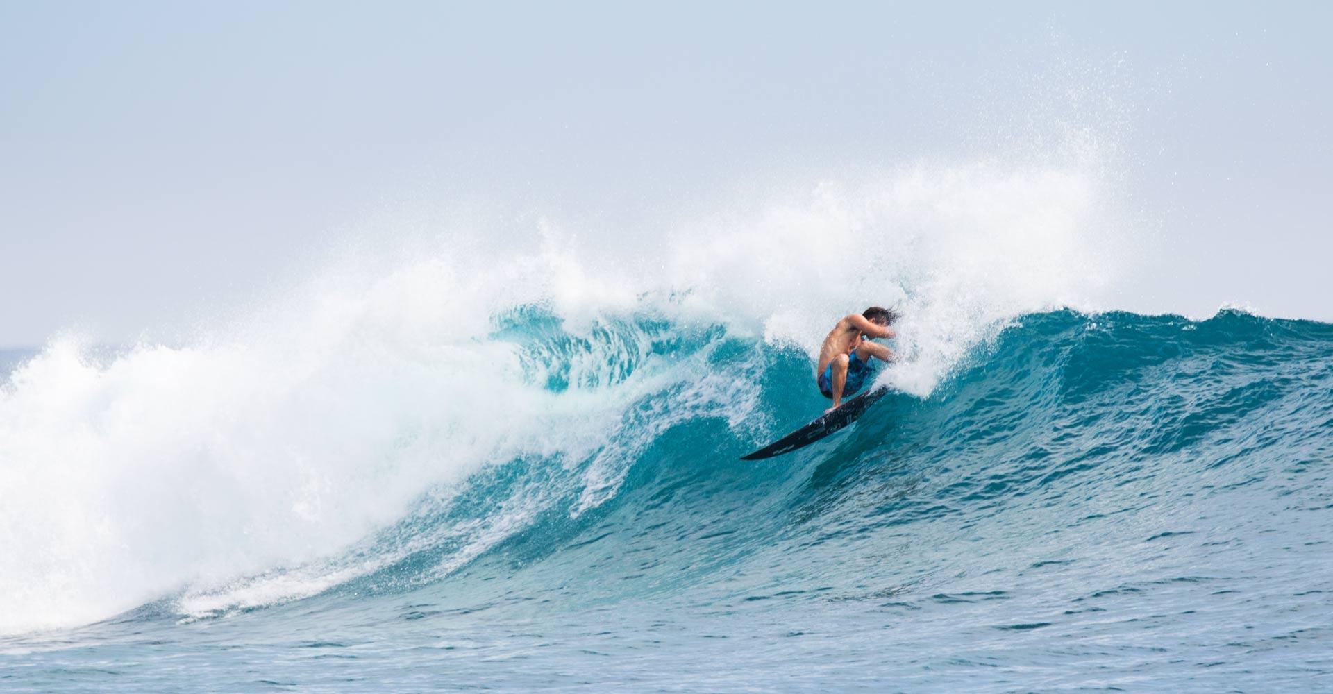 Jackson Coffey Surfing in front of Niyama Surf Resort