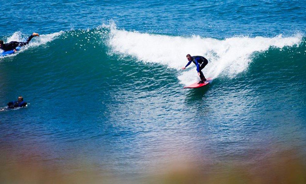 Surf beginner on a green wave.