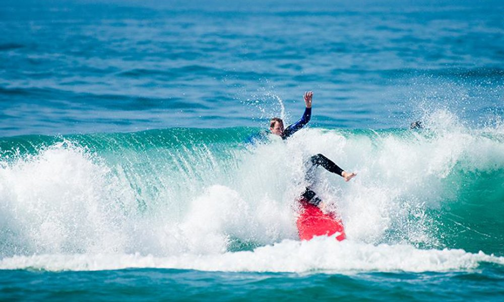 Surf student wipe-out in Ericeira