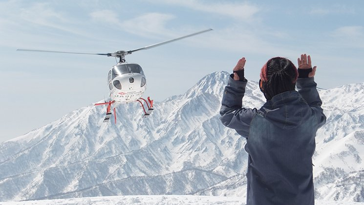 Heliskiing in Japan's deep poweder