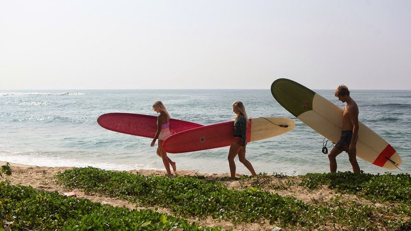 Girls longboarding and surfing in sri lanka