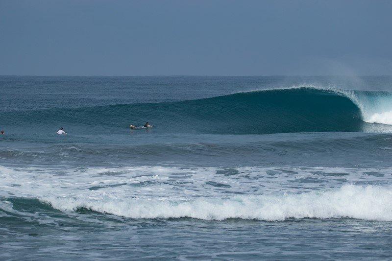 Surfing empty lineups in Krui