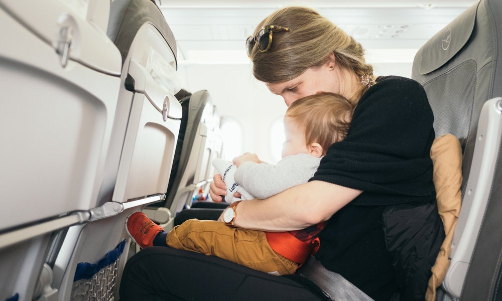 Mother with child on plane