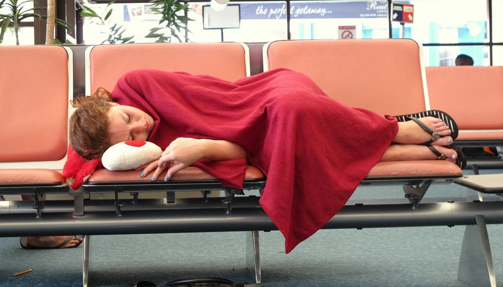 sleeping at the airport is exhausting
