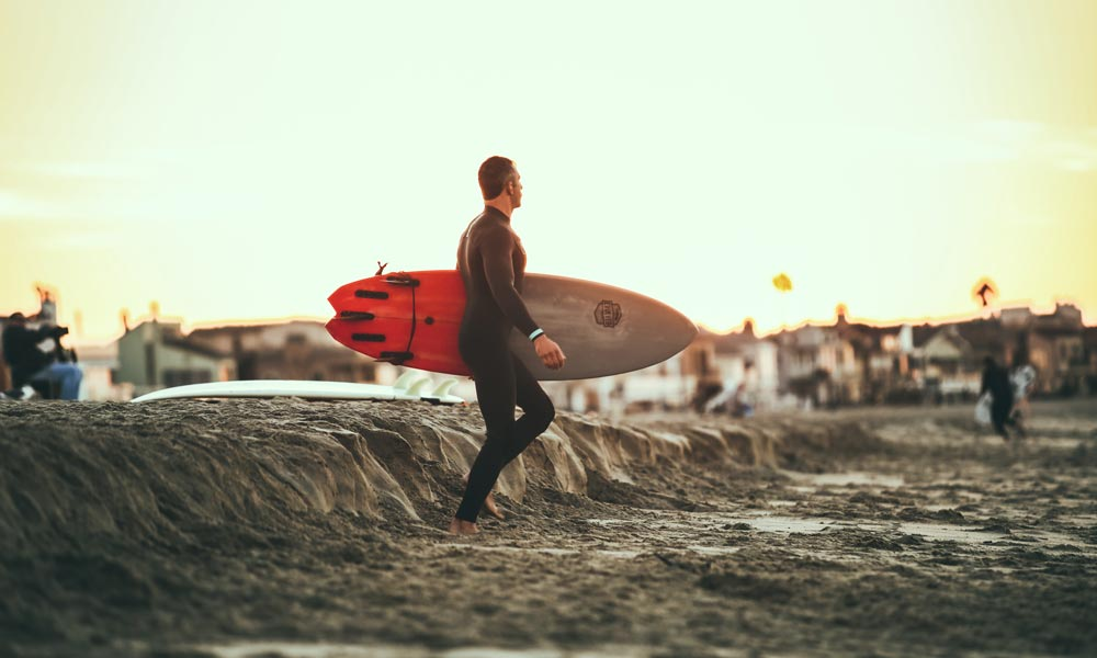 Surfer with wider surfboard